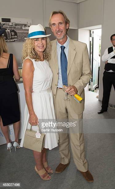Mike Rutherford and wife Angie Rutherford attend the L'Ormarins lunch at Glorious Goodwood at Goodwood on August 1 2014 in Chichester England