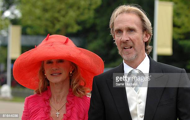 Mike Rutherford of Genesis arrives with wife Angie Rutherford on day 4 of Royal Ascot on June 20 2008 in Ascot England