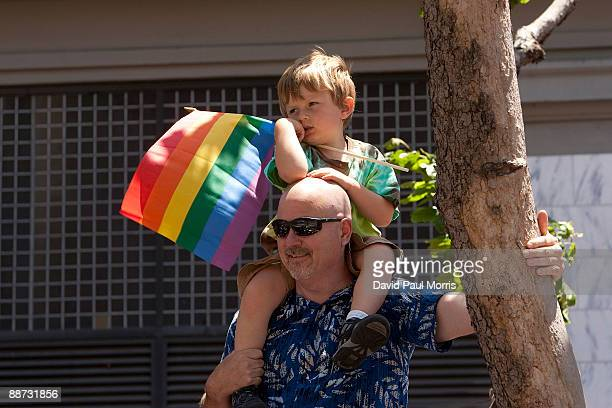 Mike Ryan holds his son Jacob, 4 on his shoulders as they watch the 39th annual gay pride parade June 28, 2009 in San Francisco, California. The 39th...