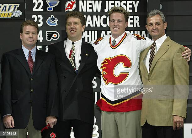Mike Sands Tod Button first round draft pick Dion Phaneuf and Darryl Sutter of the Calgary Flames pose for a portrait on stage during the 2003 NHL...