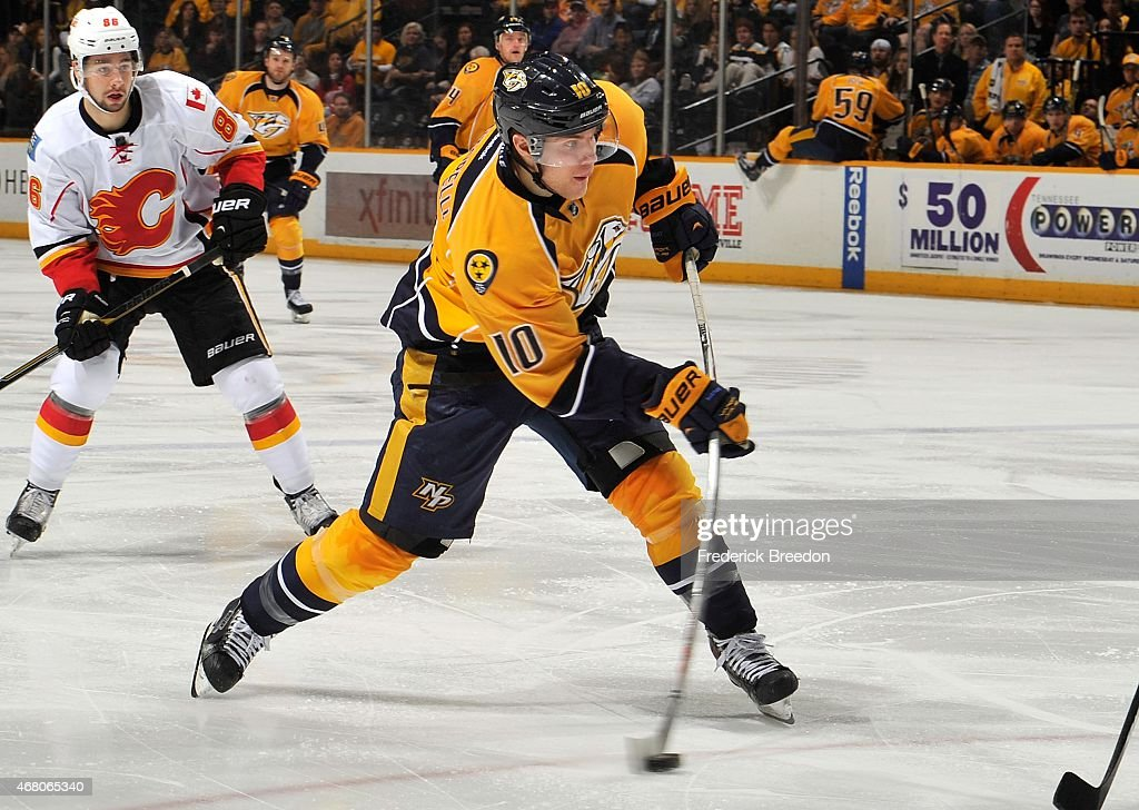 Mike Santorelli #10 of the Nashville Predators fires a shot against the Calgary Flames during the third period at Bridgestone Arena on March 29, 2015 in Nashville, Tennessee.
