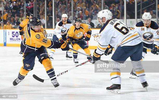 Mike Santorelli of the Nashville Predators fires a shot on net against Andre Benoit of the Buffalo Sabres during an NHL game at Bridgestone Arena on...