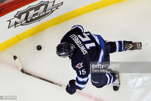 Mike Santorelli of the Winnipeg Jets plays the puck along the corner boards during third period action against the Tampa Bay Lightning at the MTS...