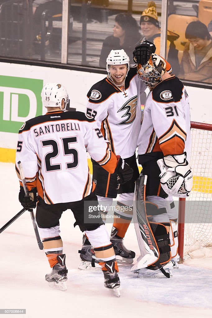 Mike Santorelli #25, Shea Theodore #53 and Frederik Andersen #31 of the Anaheim Ducks celebrate a win against the Boston Bruins at the TD Garden on January 26, 2016 in Boston, Massachusetts.
