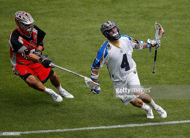Mike Sawyer of the Charlotte Hounds controls the ball against Max Schmidt of the Colorado Hounds at Sports Authority Field at Mile High on May 3 2015...