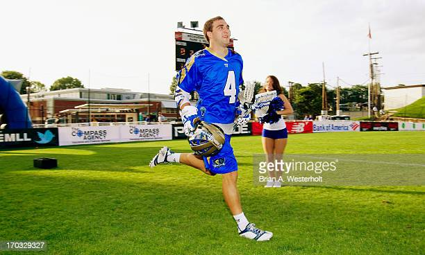 Mike Sawyer of the Charlotte Hounds takes the field prior to the game against the Ohio Machine at American Legion Memorial Stadium on June 8 2013 in...