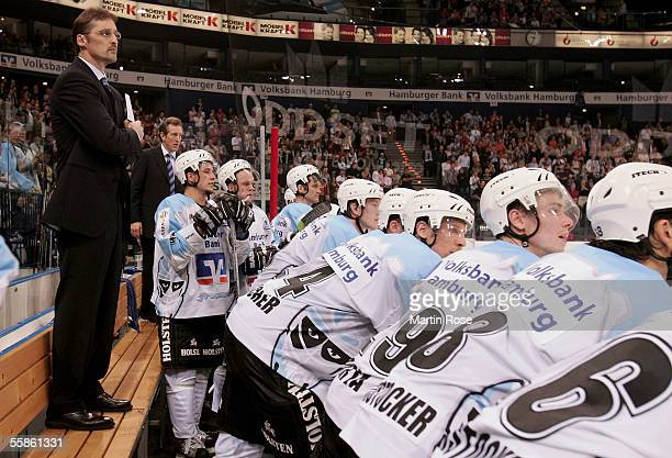 Mike Schmidt headcoach of Hamburg stands on the bench and watches the penalty shoot out in the DEL match between Hamburg Freezers and Nuernberg Ice...