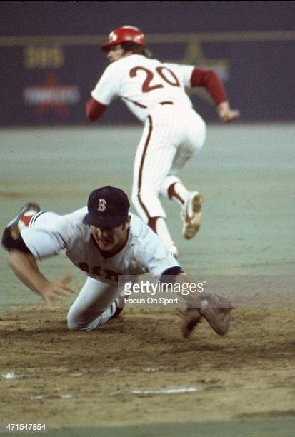 Mike Schmidt of the Philadelphia Phillies and the National League AllStars takes off for second base as the ball is thrown past Carl Yastrzemski of...