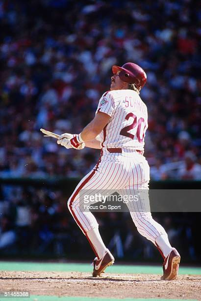 Mike Schmidt of the Philadelphia Phillies breaks his bat while hitting against the Baltimore Orioles during the World Series at Veterans Stadium in...