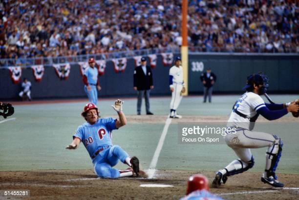 Mike Schmidt of the Philadelphia Phillies slides into home during the World Series against the Kansas City Royals at Royals Stadium in Kansas City,...