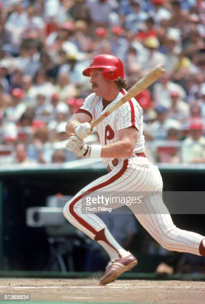 Mike Schmidt of the Philadelphia Phillies watches the flight of the ball as he follows through on a swing circa 19721989 at Veterans Stadium in...