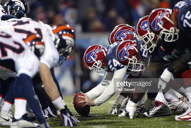 Mike Schneck of the Buffalo Bills is set to hike the ball during the NFL game with the Denver Broncos on December 17, 2005 at Ralph Wilson Stadium in...