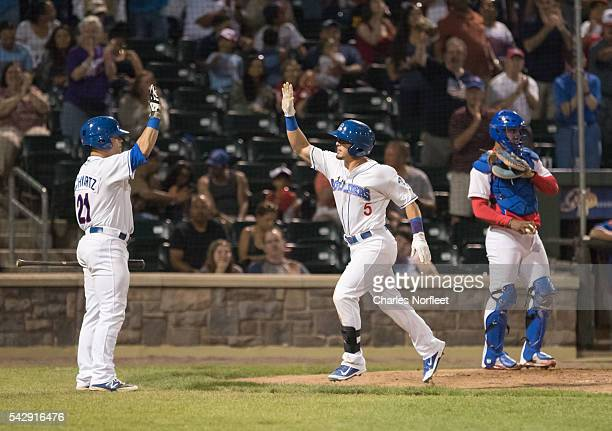 Mike Schwartz congratulates Junior Arrojo after his home run against the Cuban National Team at Palisades Credit Union Park on June 24, 2016 in...
