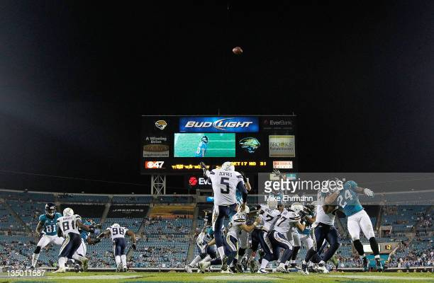 Mike Scifres of the San Diego Chargers punts during a game against the Jacksonville Jaguars at EverBank Field on December 5 2011 in Jacksonville...