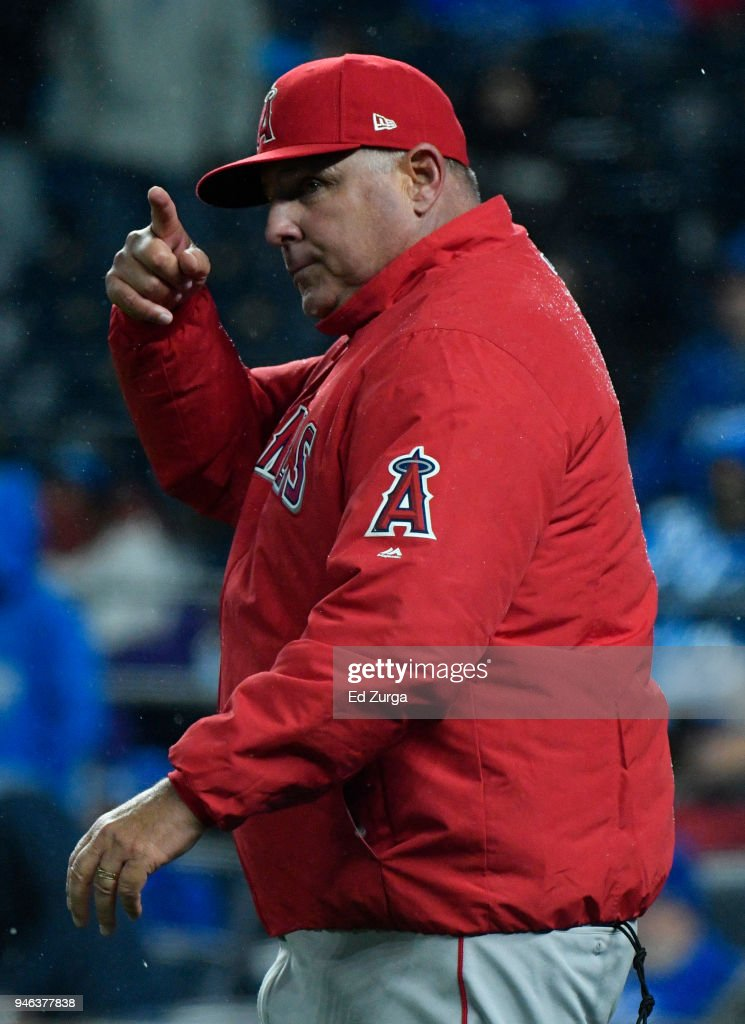 Mike Scioscia #14 manager of the Los Angeles Angels of Anaheim signals for a pitching change in the seventh inning against the Kansas City Royals at Kauffman Stadium on April 14, 2018 in Kansas City, Missouri.