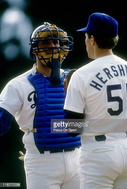 Mike Scioscia of the Los Angeles Dodgers talks with pitcher Orel Hershiser during a MLB baseball game circa 1989 at Dodger Stadium in Los Angeles...
