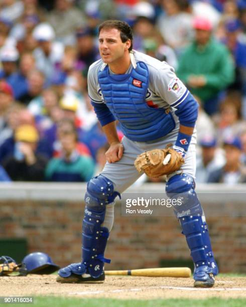 Mike Scoscia of the Los Angeles Dodgers catches during an MLB game against the Chicago Cubs at Wrigley Field in Chicago Illinois during the 1992...