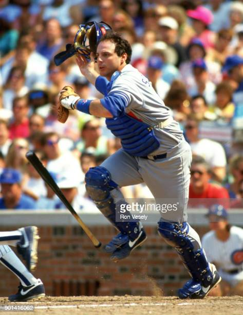 Mike Scoscia of the Los Angeles Dodgers catches during an MLB game against the Chicago Cubs at Wrigley Field in Chicago Illinois during the 1985...