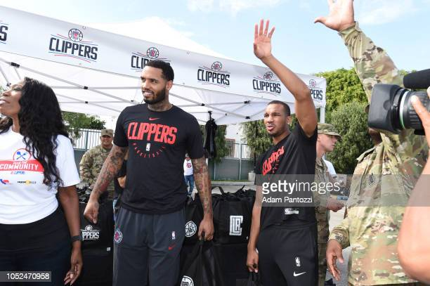 Mike Scott and Avery Bradley of the LA Clippers distribute food and personal care items on October 13 2018 at the Salvation Army Siemon Family Youth...