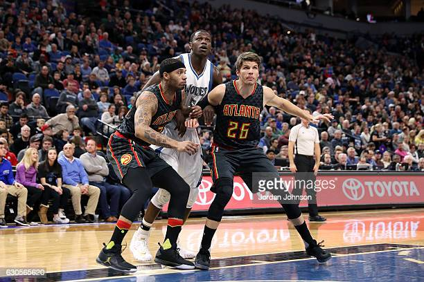Mike Scott and Thabo Sefolosha of the Atlanta Hawks fight for the position against Gorgui Dieng of the Minnesota Timberwolves on December 26 2016 at...