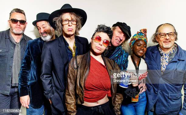Mike Scott and The Waterboys pose backstage following an instore session to celebrate the launch of their new album 'Where The Action Is' at HMV...