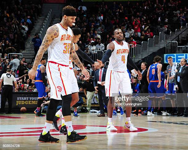Mike Scott Kent Bazemore and Paul Millsap of the Atlanta Hawks during the game against the New York Knicks on January 5 2016 at Philips Arena in...