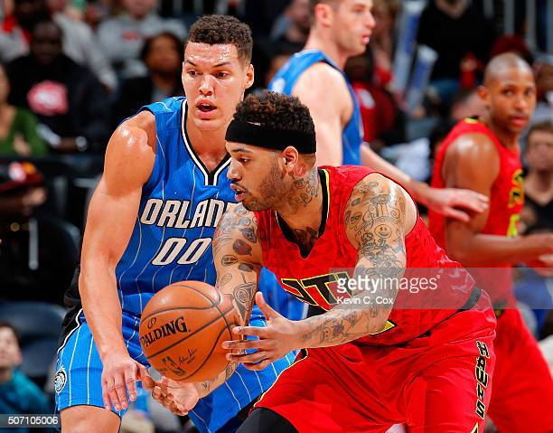 Mike Scott of the Atlanta Hawks against Aaron Gordon of the Orlando Magic at Philips Arena on January 18 2016 in Atlanta Georgia NOTE TO USER User...