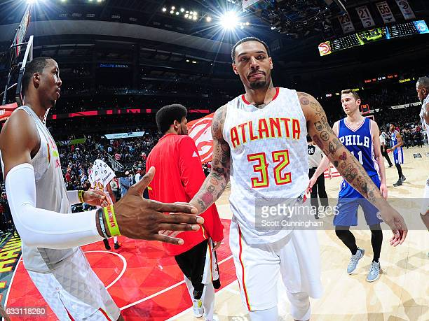 Mike Scott of the Atlanta Hawks and Dwight Howard of the Atlanta Hawks high five each other after the game against the Philadelphia 76ers on January...