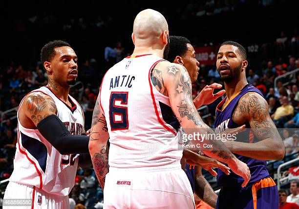 Mike Scott of the Atlanta Hawks and Gerald Green of the Phoenix Suns attempt to break up an altercation between Pero Antic and Markieff Morris which...
