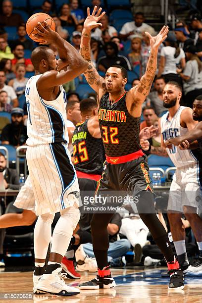 Mike Scott of the Atlanta Hawks plays defense against Serge Ibaka of the Orlando Magic during a preseason game on October 16 2016 at Amway Center in...