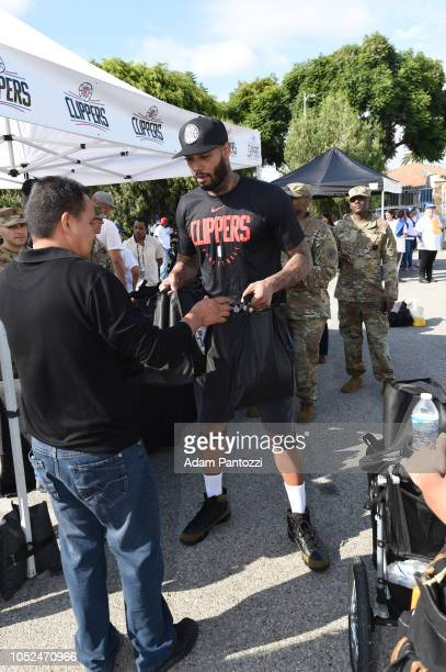 Mike Scott of the LA Clippers distributes food and personal care items on October 13 2018 at the Salvation Army Siemon Family Youth Community Center...