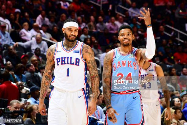 Mike Scott of the Philadelphia 76ers and Kent Bazemore of the Atlanta Hawks share a laugh during the game on April 3 2019 at State Farm Arena in...