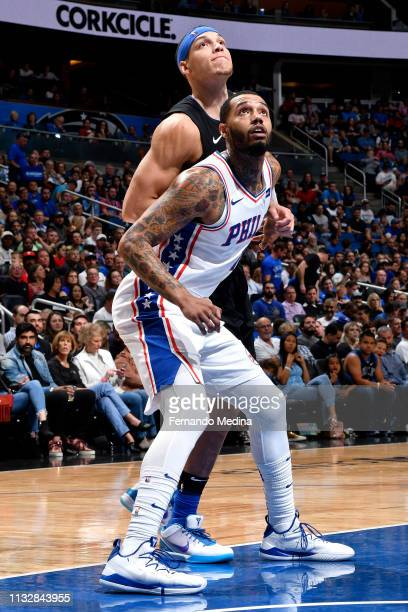 Mike Scott of the Philadelphia 76ers defends Aaron Gordon of the Orlando Magic on March 25 2019 at Amway Center in Orlando Florida NOTE TO USER User...