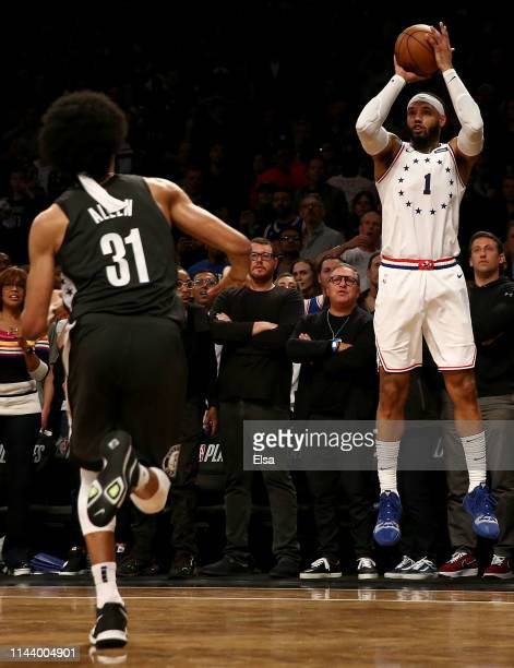 Mike Scott of the Philadelphia 76ers shoots a three point shot as Jarrett Allen of the Brooklyn Nets defends in the final minutes of the game to take...