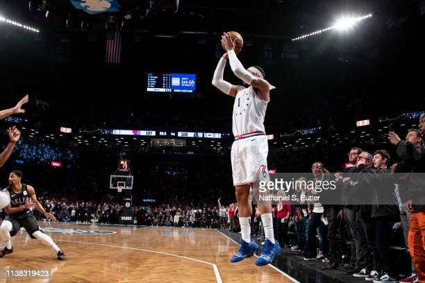 Mike Scott of the Philadelphia 76ers shoots a three pointer to give the 76ers the lead late in the 4th quarter against the Brooklyn Nets during Game...