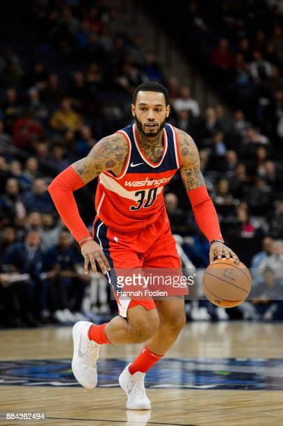 Mike Scott of the Washington Wizards dribbles the ball against the Minnesota Timberwolves during the game on November 28 2017 at the Target Center in...