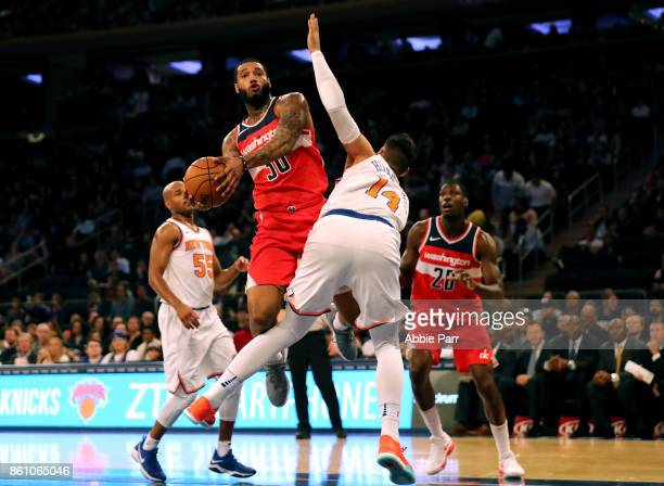 Mike Scott of the Washington Wizards goes to take a shot against Willy Hernangomez of the New York Knicks in the first half during their Pre Season...