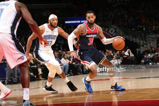 Mike Scott of the Washington Wizards handles the ball against Adreian Payne of the Orlando Magic on December 23 2017 at Capital One Arena in...
