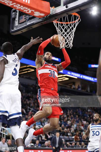 Mike Scott of the Washington Wizards handles the ball against the Minnesota Timberwolves on November 28 2017 at Target Center in Minneapolis...