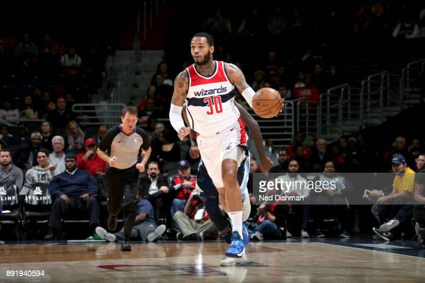 Mike Scott of the Washington Wizards handles the ball against the Memphis Grizzlies on December 13 2017 at Capital One Arena in Washington DC NOTE TO...