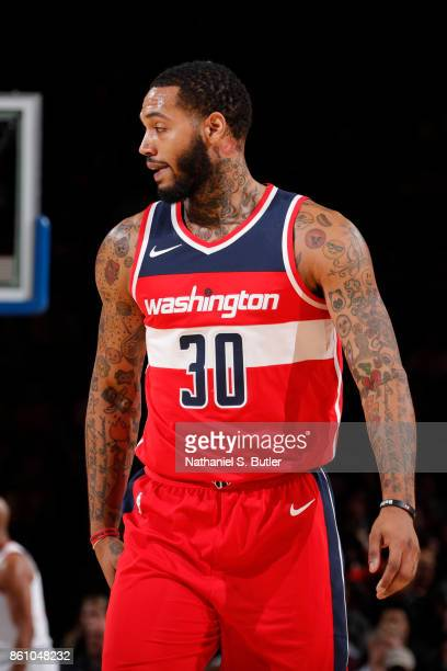Mike Scott of the Washington Wizards looks on during the game against the New York Knicks on October 13 2017 at Madison Square Garden in New York...