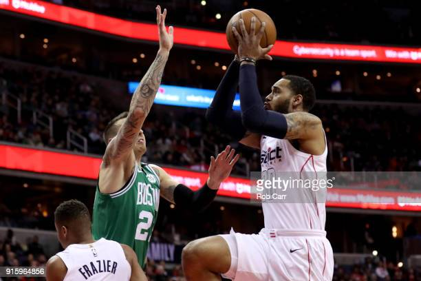Mike Scott of the Washington Wizards puts up a shot over Daniel Theis of the Boston Celtics at Capital One Arena on February 8 2018 in Washington DC...
