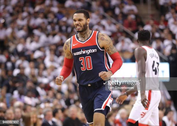 Mike Scott of the Washington Wizards reacts after scoring a threepointer against the Toronto Raptors in the third quarter during Game One of the...