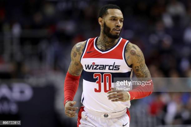 Mike Scott of the Washington Wizards runs up the floor after hitting a three pointer in the first half against the New Orleans Pelicans at Capital...