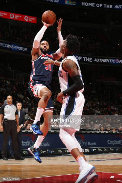 Mike Scott of the Washington Wizards shoots the ball against the Orlando Magic on December 23 2017 at Capital One Arena in Washington DC NOTE TO USER...