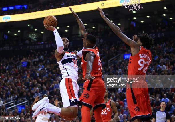 Mike Scott of the Washington Wizards shoots the ball as Delon Wright of the Toronto Raptors defends during the first half of an NBA game at Air...