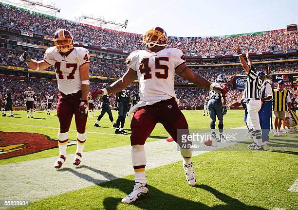 Mike Sellers of the Washington Redskins celebrates his touchdown with Chris Cooley against the Seattle Seahawks on October 2 2005 at Fed Ex Field in...