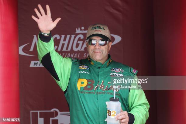 Mike Senica driver of the unsponsored Chevrolet greets fans during the prerace ceremonies of the Camping World Truck Series LTi Printing 200 race on...