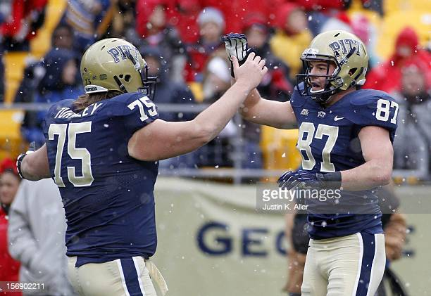 Mike Shanahan of the Pittsburgh Panthers celebrates after a first half touchdown catch against the Rutgers Scarlet Knights during the game on...