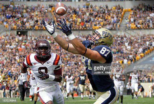 Mike Shanahan of the Pittsburgh Panthers makes a forty yard reception against Detrick Bonner of the Virginia Tech Hokies during the game on September...